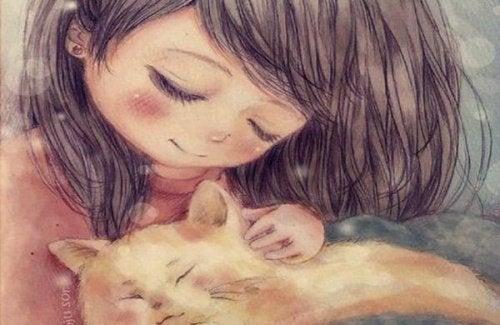 طفلة تحتضن قطة
